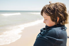 Boy standing on the beach Royalty Free Stock Photos