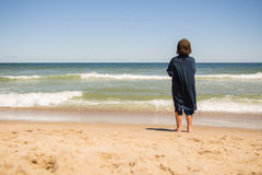 Boy standing on the beach Royalty Free Stock Images