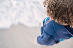 Boy standing on the beach Royalty Free Stock Photography