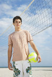 Boy Standing On Beach Volleyball Court Stock Image