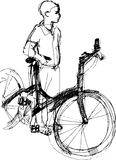 Boy standing with bicycle Royalty Free Stock Images
