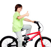 Boy standing on a bike Royalty Free Stock Photography