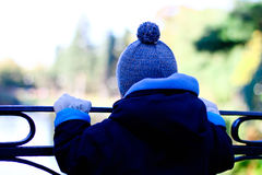 Boy Standing On The Bridge Royalty Free Stock Photos