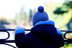 Boy Standing On The Bridge Royalty Free Stock Photos