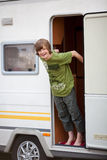 Boy Standing At Caravan Entrance Stock Image