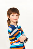 Boy standing confidently with his arms folded stock photo