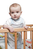 Boy standing in the crib Royalty Free Stock Photography
