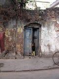 Boy standing in the doorway Stock Image