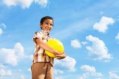 Boy standing with football ball Stock Photos
