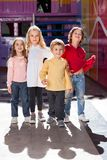 Boy Standing With Friends In Kindergarten Stock Photography