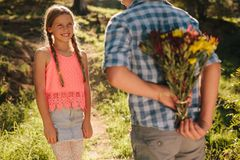 Happy kids in love standing in a park royalty free stock photography