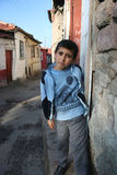 A boy standing in front of his house Stock Photo