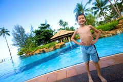 Boy standing in front of pool Stock Photography