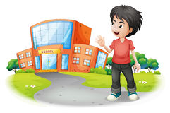 A boy standing in front of the school Royalty Free Stock Photos