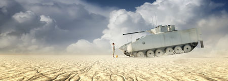Boy standing in front of a tank