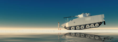 boy standing in front of a tank Royalty Free Stock Photo