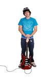 Boy standing with guitar. Stock Photography