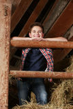 Boy standing on the haystack Royalty Free Stock Photos