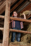 Boy standing on the haystack Royalty Free Stock Images