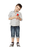 Boy standing and holding heart Royalty Free Stock Photo