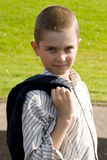 Boy standing and holding a sweater Stock Image