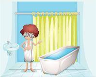 A boy standing inside the comfort room Stock Images