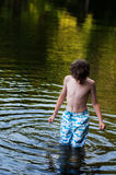 Boy standing in a lake. Young boy standing in a lake in Haliburton County Ontario stock photography