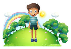 A boy standing in the middle of the hill Royalty Free Stock Images