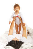 Boy standing on mommy Royalty Free Stock Photography