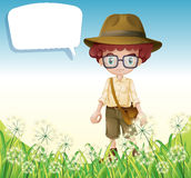 A boy standing near the grass with an empty callout Royalty Free Stock Photography