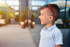 Boy standing near mirror window Stock Image