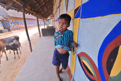 The Boy. A boy standing at the newly painted mud wall at purulia -WestBengal royalty free stock photography