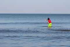 Boy standing in the ocean Royalty Free Stock Photography