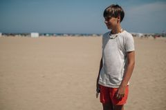 Free Boy Standing On The Sunny Beach And Smiling Stock Photography - 127037482