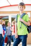 Boy Standing Outside School With Rucksack. Boy Stands Outside School With Rucksack Stock Photography