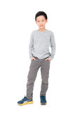 Boy standing over white background Royalty Free Stock Images