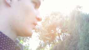 Boy is standing in a park in the setting sun Stock Images