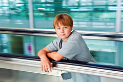 Boy standing on a passenger conveyor in the airport Stock Photography