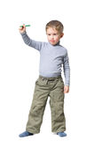 Boy standing with pencil in hand Royalty Free Stock Image