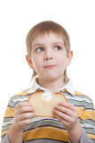 Boy standing with piece of bread Stock Photography