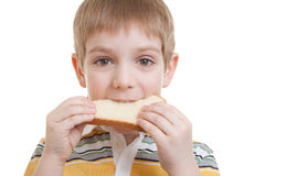 Boy standing with piece of bread Stock Image