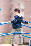 Boy standing on playground Stock Photos