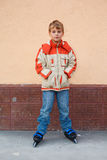 Boy standing on roller skates Stock Photo