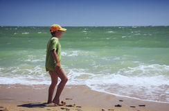 Boy standing at sea Stock Photo