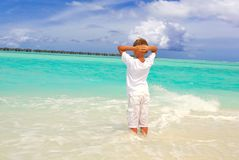 Boy standing in sea Stock Image