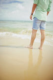 Boy standing in sea on Bournemouth Beach Royalty Free Stock Images