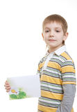 Boy standing with sheet of paper Royalty Free Stock Image