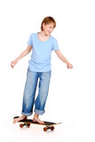 Boy standing on skateboard Royalty Free Stock Photo