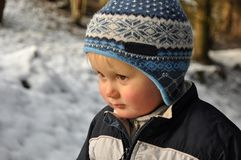 Boy standing in snowy forest Royalty Free Stock Images