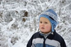 Boy standing in snowy scenery Stock Photo